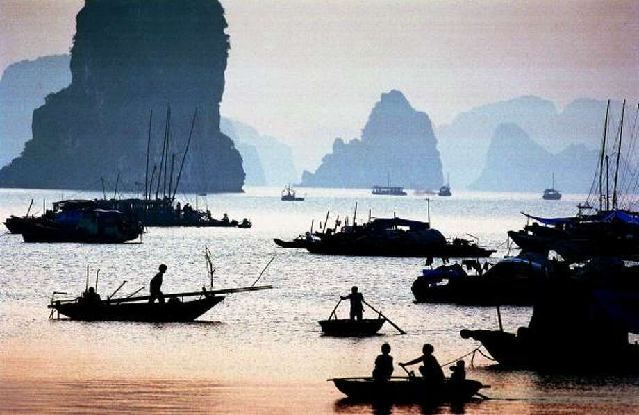 Halong Bay in Vietnam is known for the limestone monolithic islands located in the bay. Many of the nearly 2,000 islands are hollow, with enormous caves and grottos. Photo: RICHARD VOGEL, AP