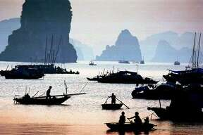 Halong Bay in Vietnam is known for the limestone monolithic islands located in the bay. Many of the nearly 2,000 islands are hollow, with enormous caves and grottos.