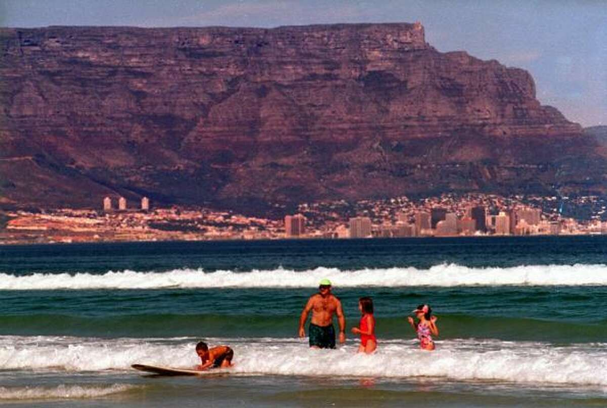 Table Mountain, South Africa : The distinctive flat top of Table Mountain overlooks Cape Town, South Africa. It is just over 3,500 feet high and spans two miles from side to side.