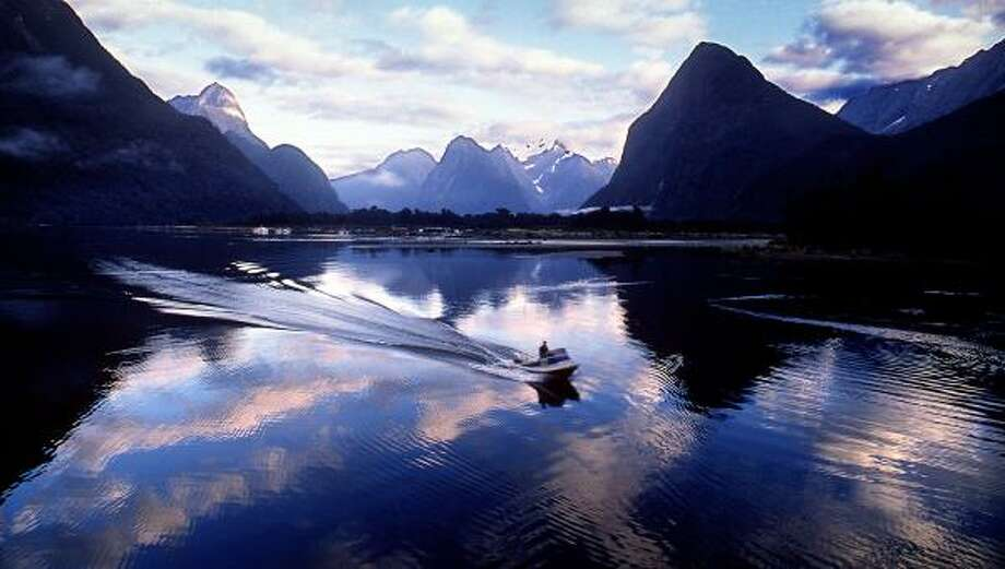 Sheer rock walls rise 3,900 feet or more on each side of Milford Sound, one of New Zealand's best-known scenic attractions. The fjord, created by receding glaciers, stretches nine miles inland from the Tasman Sea. Photo: BRUCE CHAMBERS, KRT