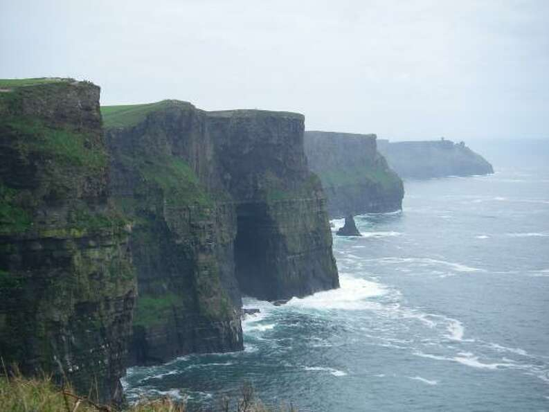 The Cliffs of Moher in Ireland extend nearly five miles, reach a maximum height of 700 feet a