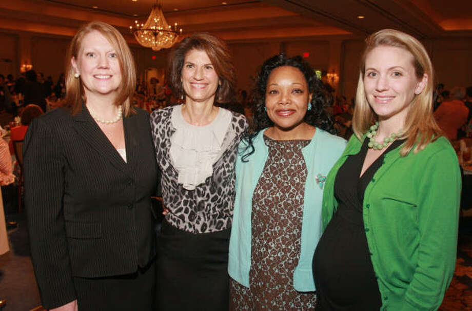 Amy Allen, from left, Laura Lopez, Dr. Yolanda Hamilton-Milton, and Elizabeth Pinion at the Women's Resource of Greater Houston 2010 luncheon. Photo: Gary Fountain, For The Chronicle