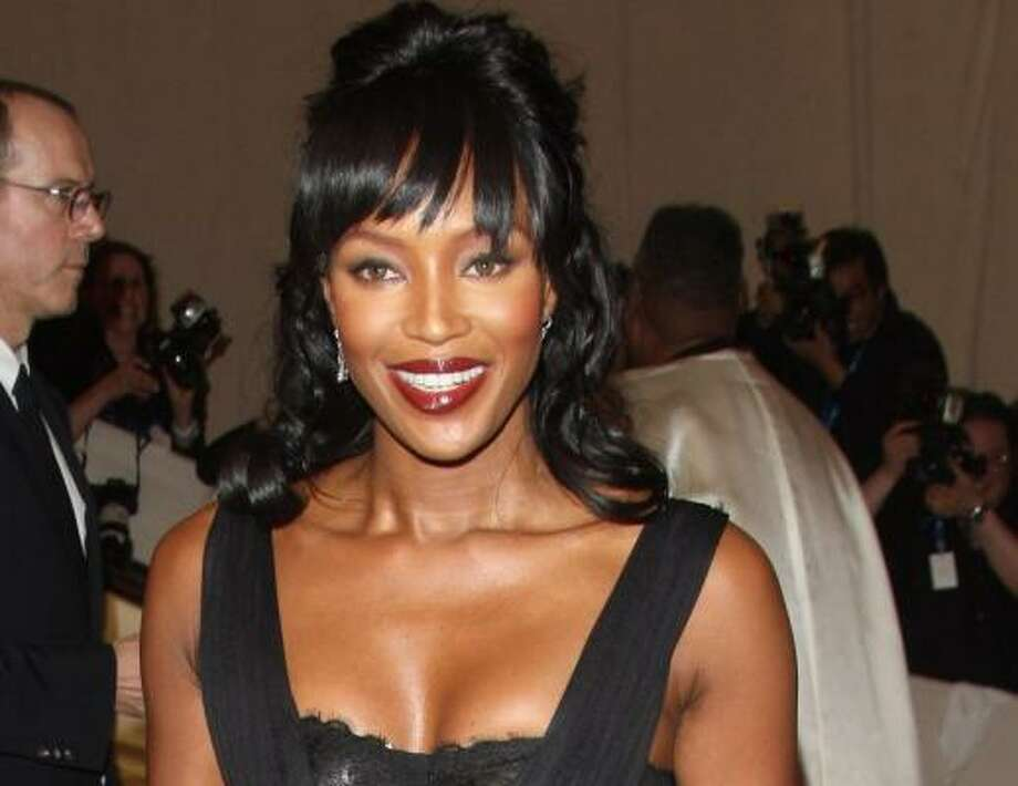 Naomi Campbell in Dolce & Gabbana looks stunning. Just watch out for flying cell phones. Photo: Peter Kramer, AP