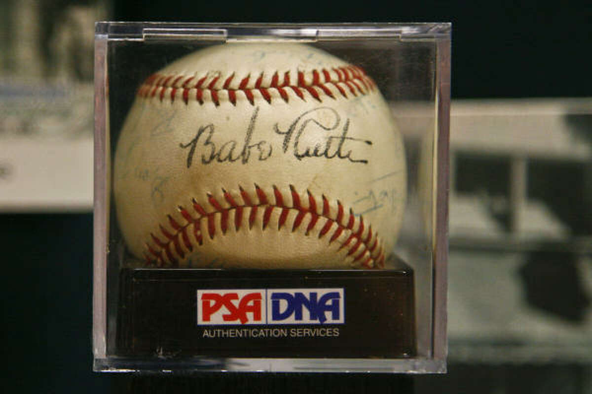 An autographed baseball signed by Babe Ruth sits in a display case at the Houston Sports Museum.