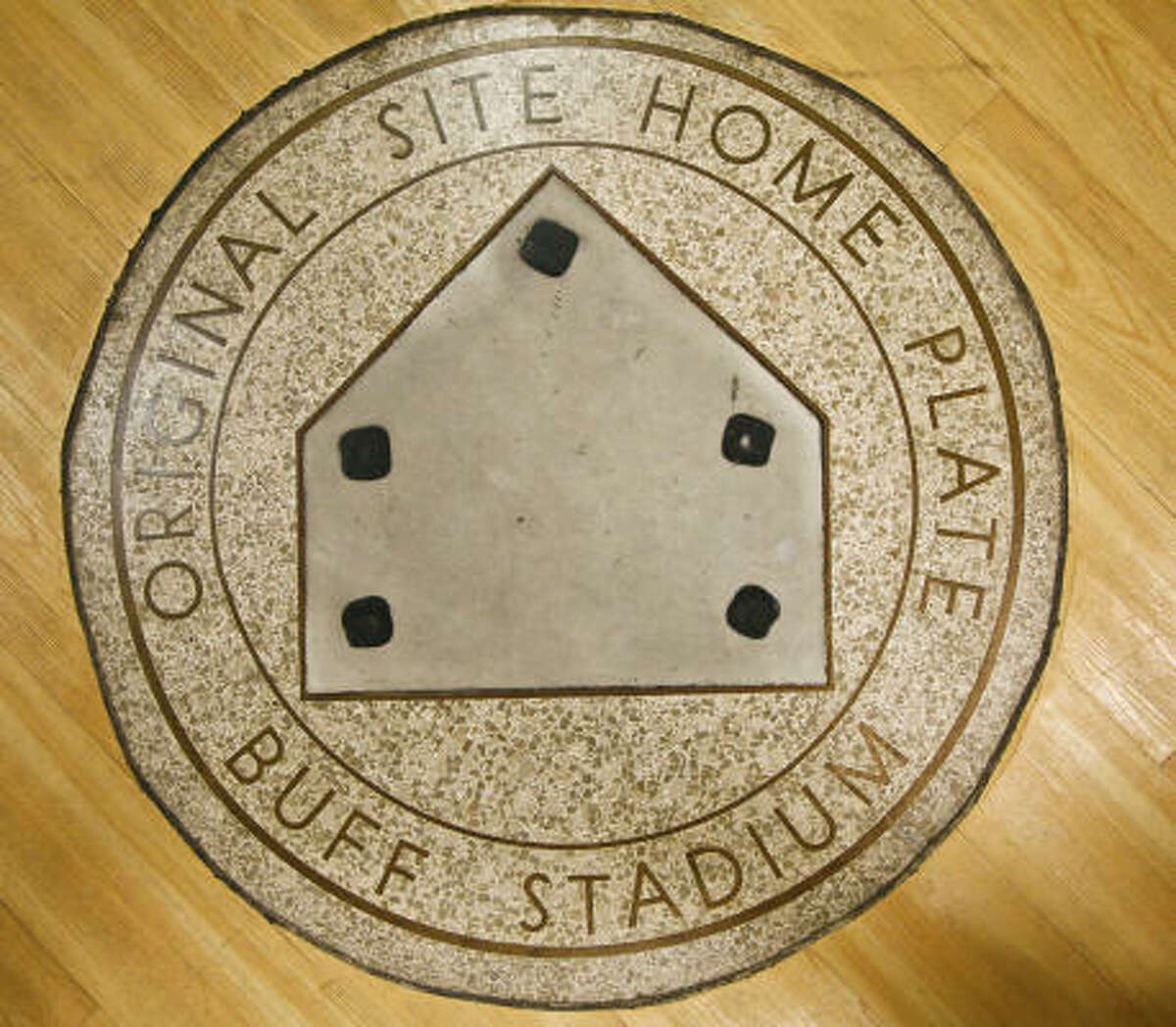The original home plate of Buff Stadium is located in the middle of the Houston Sports Museum.