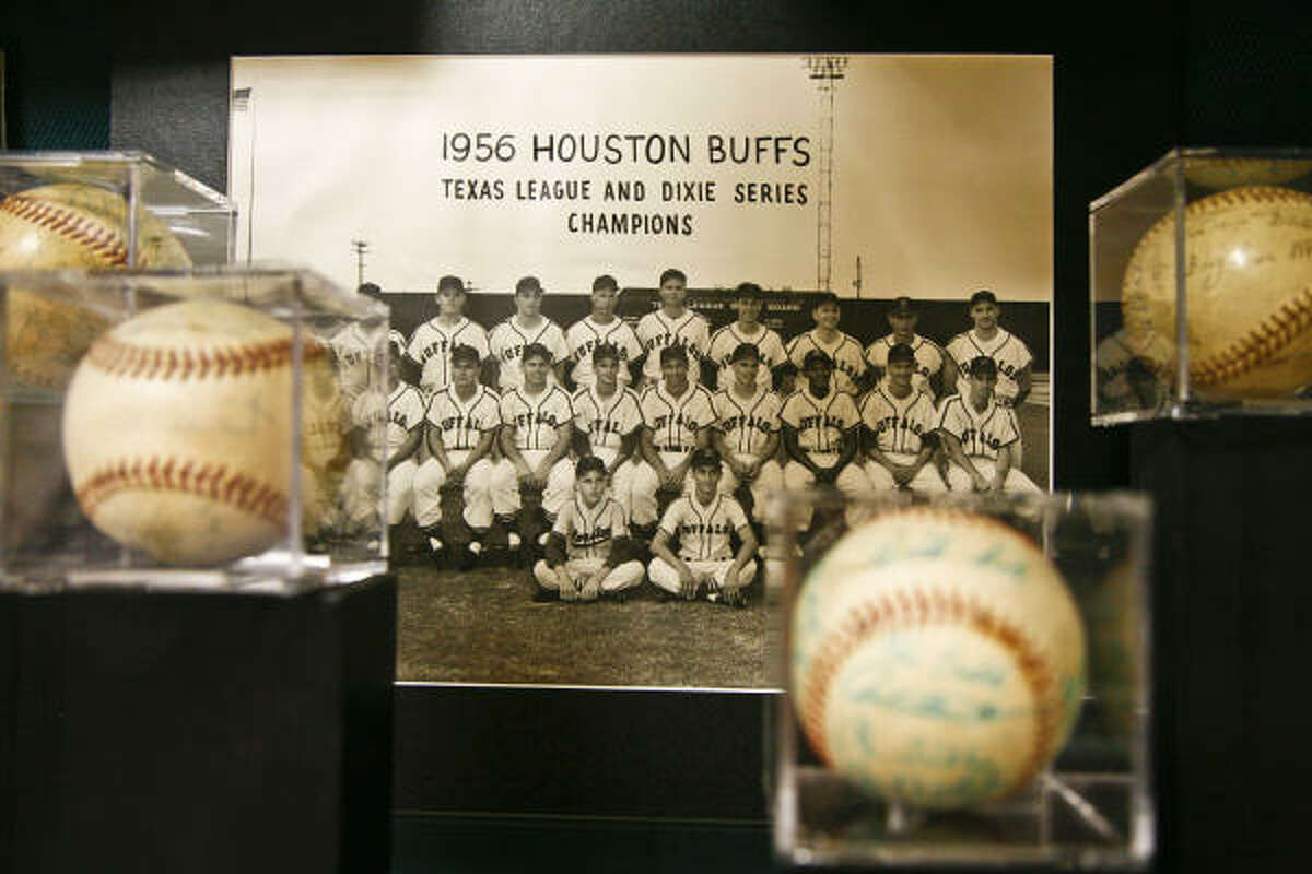 A photograph of the Houston Buffs baseball team sits in a display case at the Houston Sports Museum.