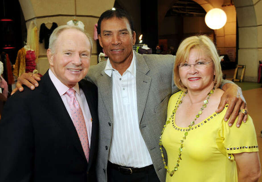 From left: Don Sanders, Jose Cruz and Zoraida Cruz at the Pink in the Park Bazaar & Brunch fundraiser at Union Station at Minute Maid Park. Photo: Dave Rossman, For The Chronicle