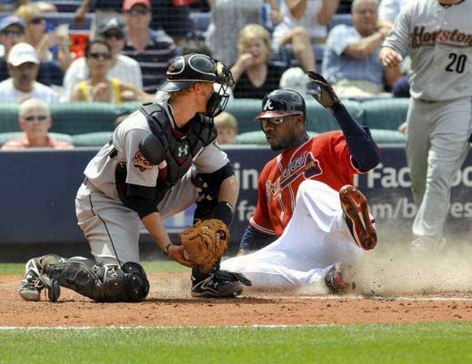 May 2: Braves 7, Astros 1Braves right fielder Jason Heyward, right, slides home safe against Astros catcher J.R. Towles, left, on a two-run double off the bat of Melky Cabrera during the fifth inning. Photo: Gregory Smith, AP