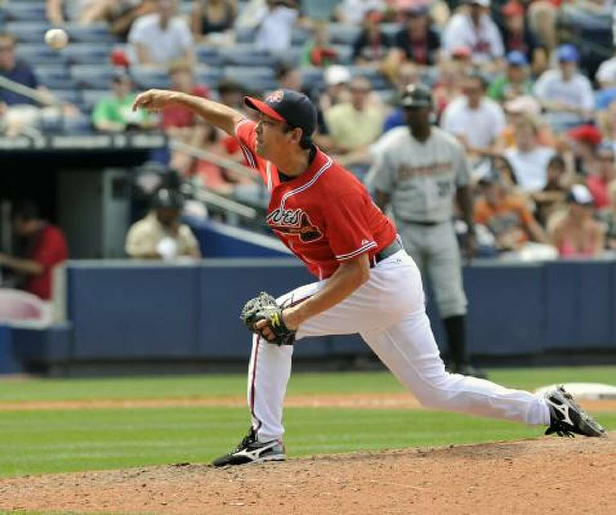 Braves reliever Takashi Saito pitches during the eighth inning.