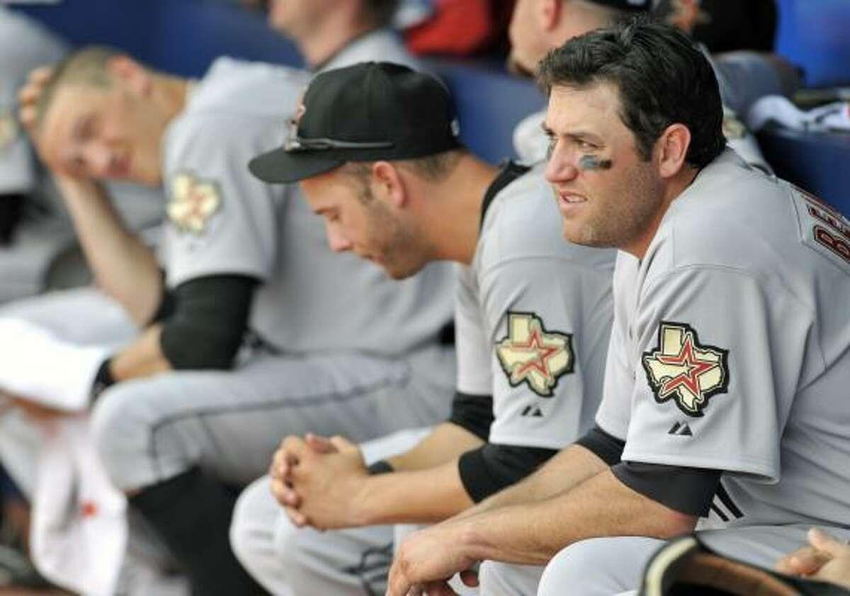 Astros first baseman Lance Berkman, right, watches his team bat against the Braves.