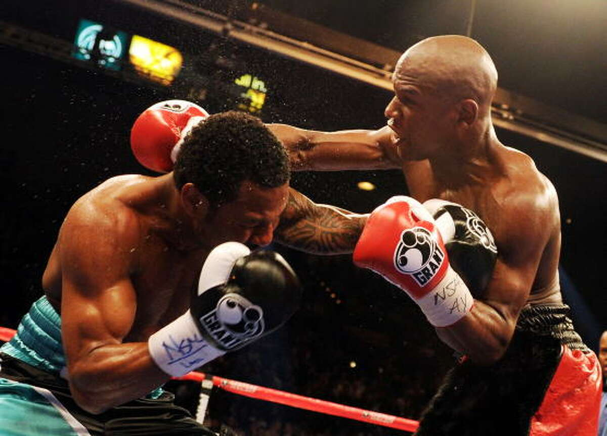 Floyd Mayweather punches Shane Mosley during their welterweight bout.