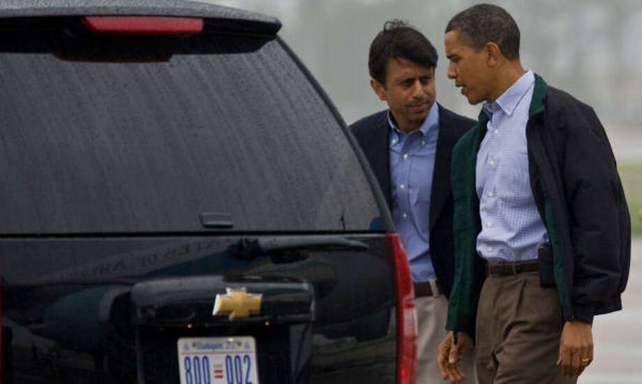 Louisiana Governor  Bobby Jindal ,left, walks with President Barack Obama after his arrival at Louis Armstrong Airport in New Orleans. President Obama then traveled by motorcade to Venice to meet with people and to see firsthand the efforts to combat the Deepwater Horizon oil spill that is threatening the Louisiana coastline. Photo: Melissa Phillip, Chronicle