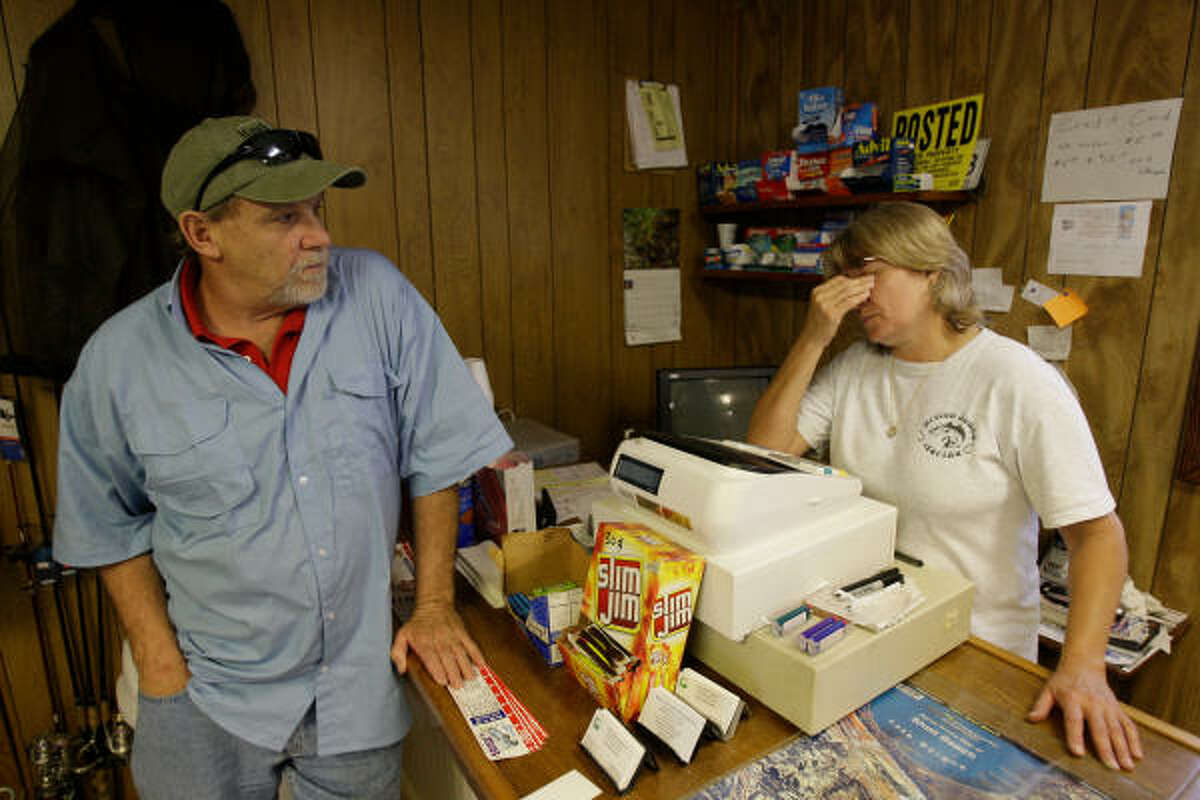 New Orleans business owners Glenn Sechurr, left, and Karen Claverie, talk about the Deepwater Horizon oil spill that is threatening the Louisiana coastline Sunday in Hopedale, La. . Both of the business owners are facing an economic and personal impact.