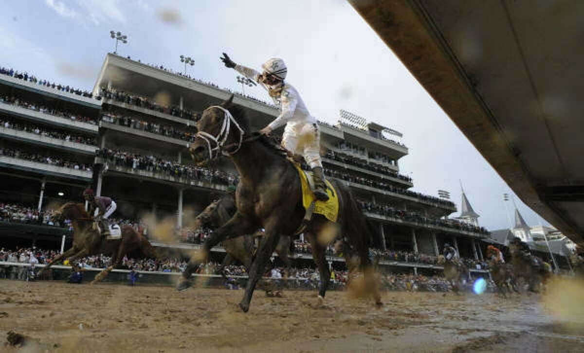 Jockey Calvin Borel blazes across the mud to his third Kentucky Derby win on Super Saver at Churchill Downs in Louisville, Kentucky.