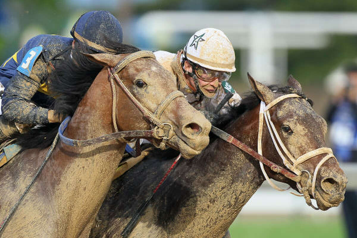 Calvin Borel rides Super Saver to the finish line for the win in the 136th running of the Kentucky Derby.