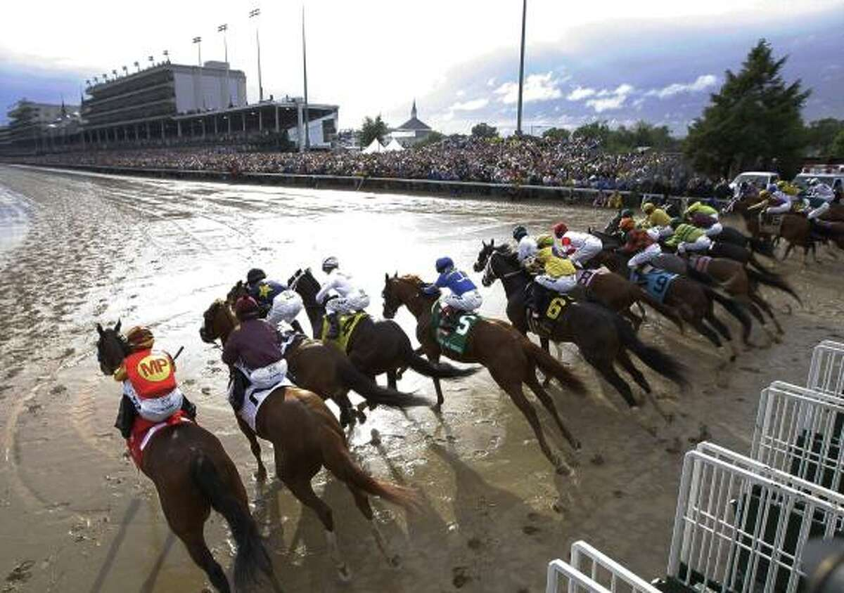 Horses leave the starting gate during the 136th Kentucky Derby horse race at Churchill Downs.