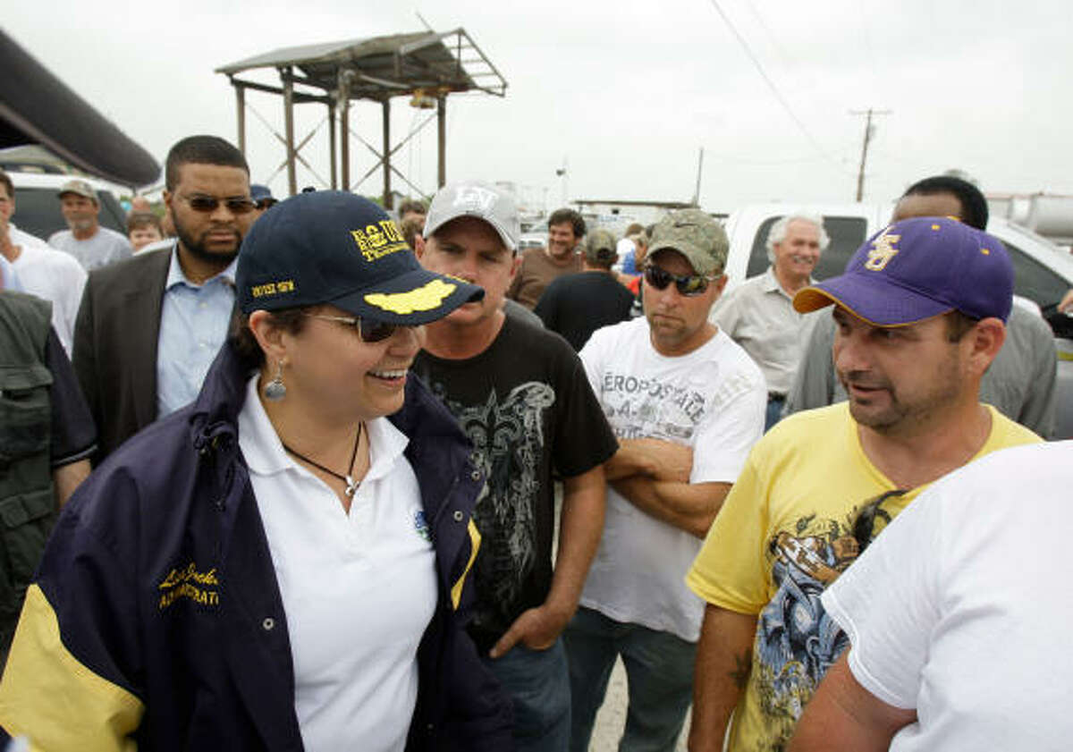 EPA Administrator Lisa Jackson talks with fisherman gathered for the Vessel of Opportunity program in Shell Beach.