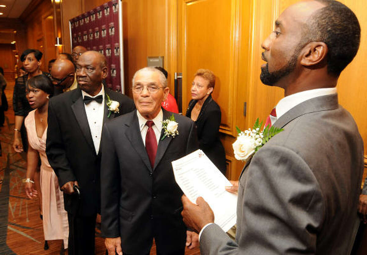 Texas Southern football coach Johnny Cole lines up inductees Horace Young, James Bo Humphrey and others before the TSU Football Hall of Fame induction ceremony Saturday at the Westin Galleria Hotel.