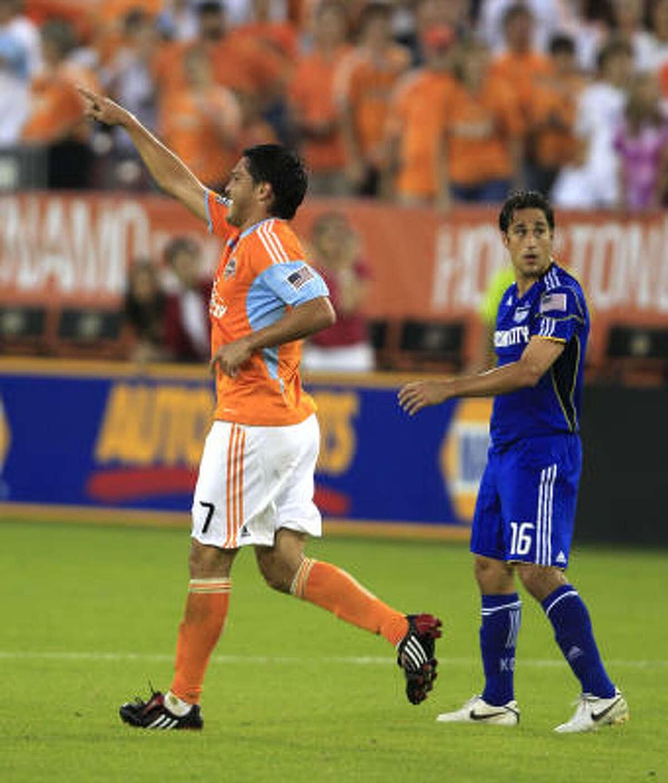 Dynamo forward Luis Landin, left, celebrates his first-half goal while running past Wizards forward Josh Wolff.