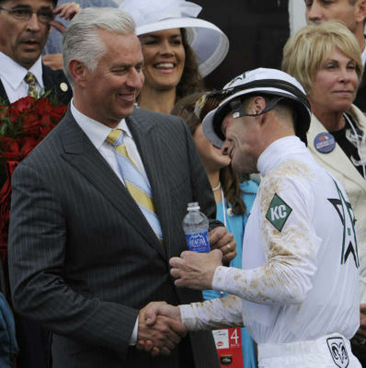 Jockey Calvin Borel is congratulated by Super Saver trainer Todd Pletcher after his first win and Borel's third Kentucky Derby victory.