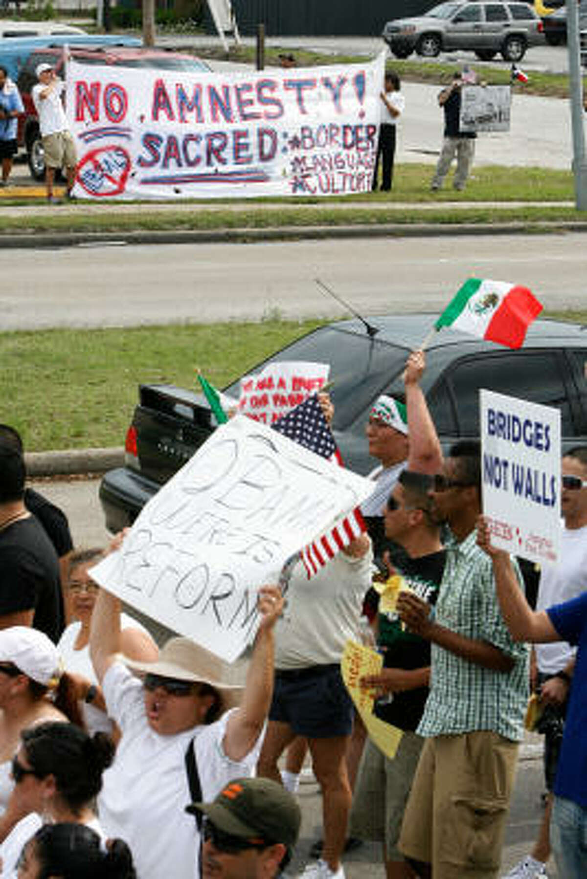 Houston: Immigration reform supporters march past counter-protesters along Bellaire Boulevard.