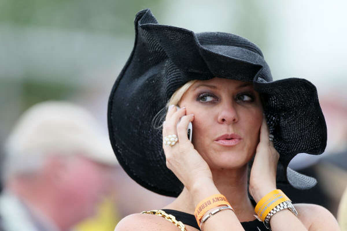A woman is seen in the grandstands wearing a hat prior to the 136th running of the Kentucky Derby.