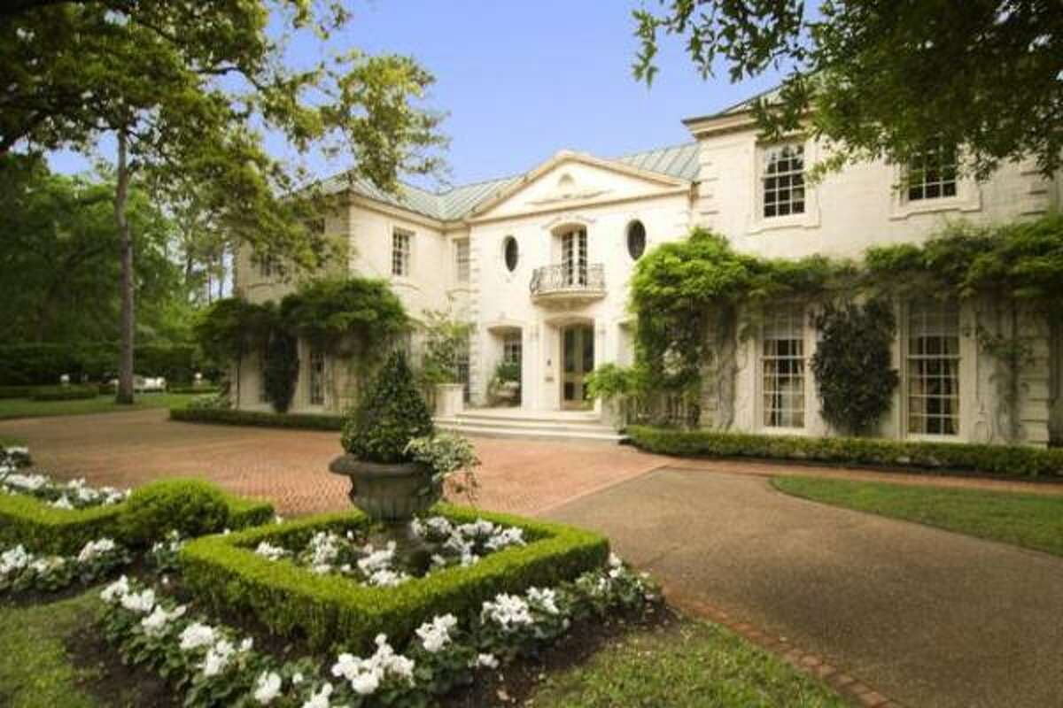 This French chateau-style home has four bedrooms, six full bathrooms and 2 half baths. It also has a $9.75 million price tag. See more photos and details here.