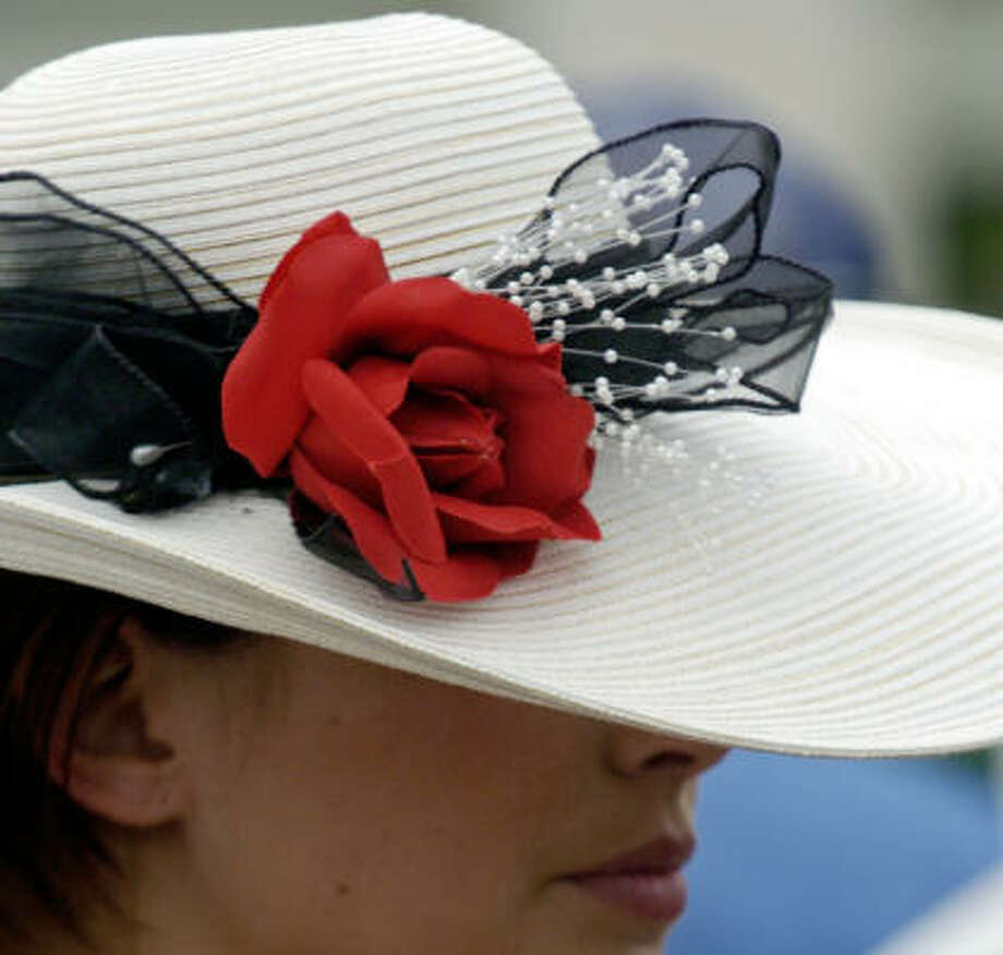 The Kentucky Derby is not just about horse racing. It's a chance for women to roll out their fancy hats and dresses and show off. Here are just a few from over the years. Photo: Tim Easley, AP