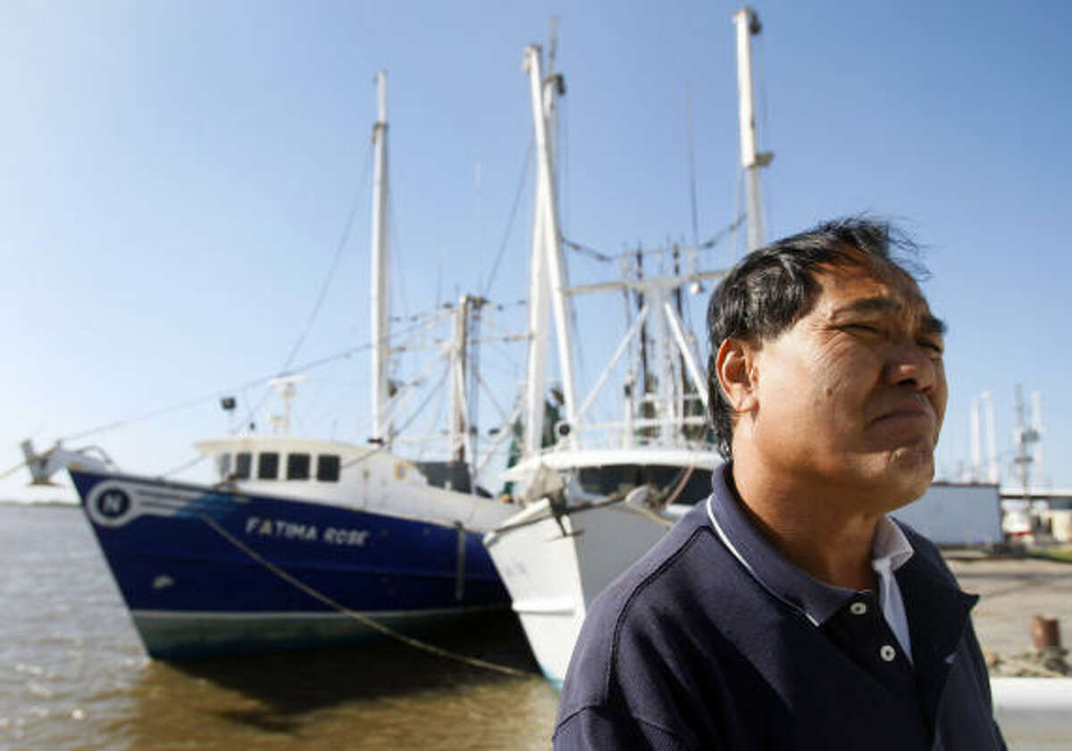 Captain Michael Nguyen stands on his fishing boat in Venice, La., Thursday, April 29, 2010. Local fishermen are worried about how their industry will withstand a growing oil spill that resulted from last week's explosion and collapse of the Deepwater Horizon oil rig in the Gulf of Mexico near the coast of Louisiana.