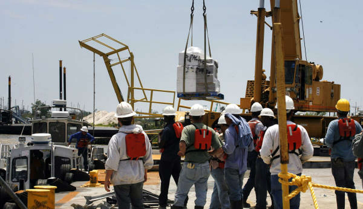 Supplies to help combat the Gulf of Mexico oil spill are transferred from the dock to crew boats and then taken to different gulf Coast locations, Thursday, April 29, 2010 at Bud's Boat Launch in Venice, La.