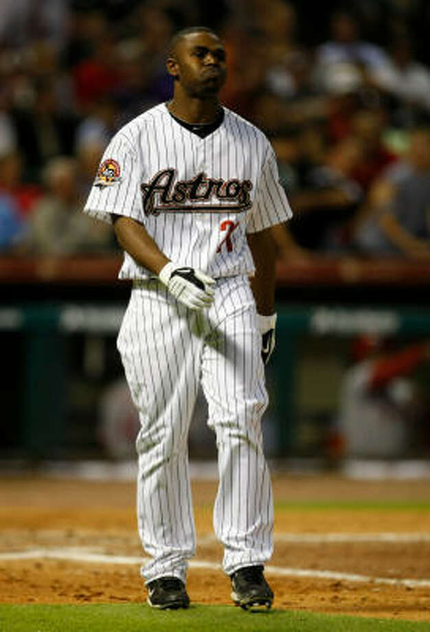 Astros center fielder Michael Bourn reacts after striking out with the bases loaded to end the fifth inning. Bourn was 0-5 with four strikeouts. Photo: Julio Cortez, Chronicle