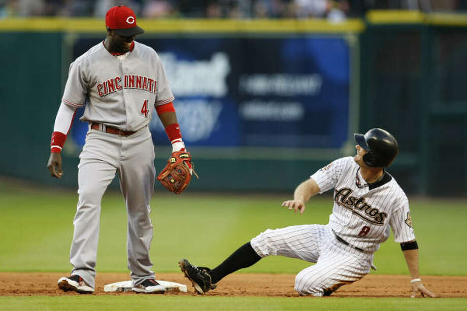 Astros second baseman Jeff Keppinger, right, laughs it up with Reds second baseman Brandon Phillips on a double play by Cincinnati in the first inning. Photo: Julio Cortez, Chronicle
