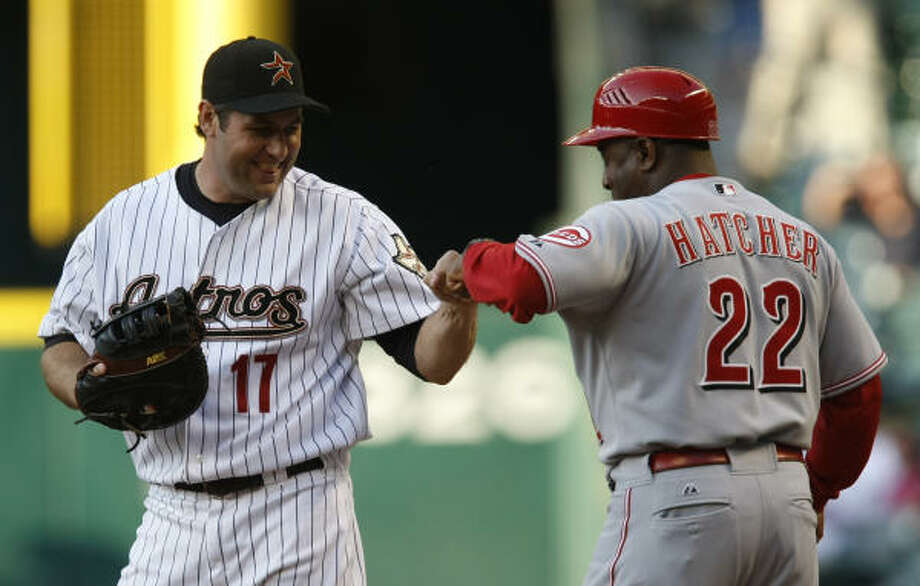 Astros first baseman Lance Berkman, left, bumps fists with Reds first base coach Billy Hatcher before the start of Wednesday's game. Photo: Julio Cortez, Chronicle