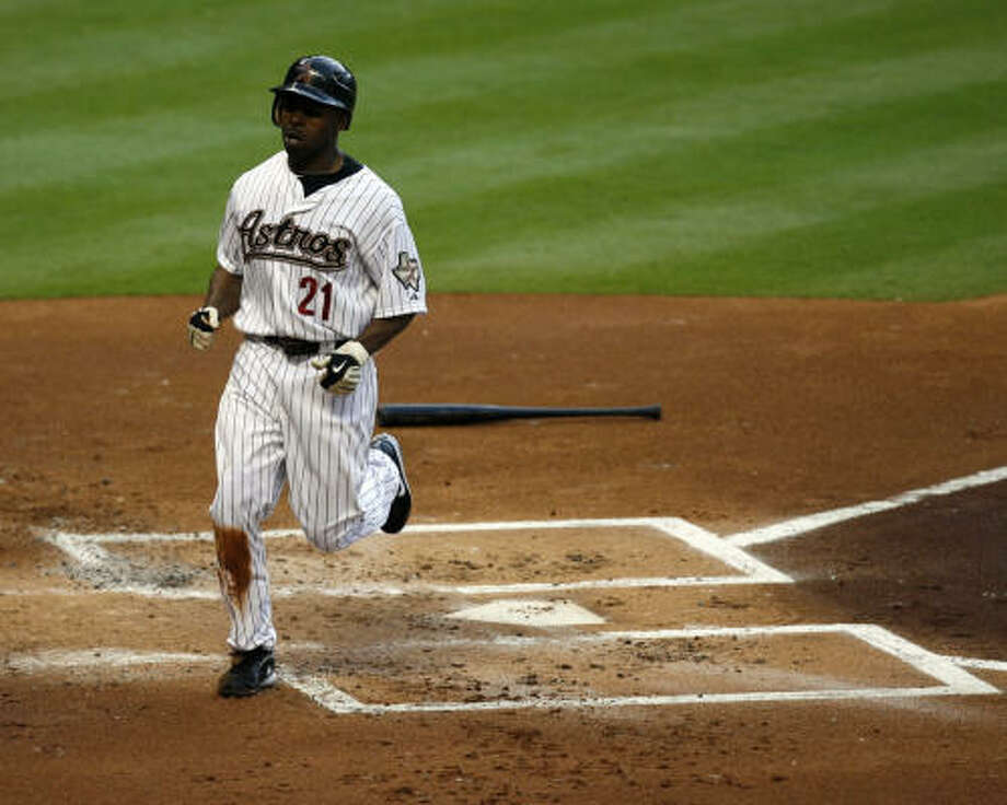 Michael Bourn crosses home plate after scoring in the first inning. Photo: Johnny Hanson, Chronicle