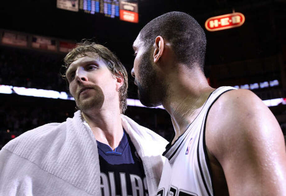 Game 6: Spurs 97, Mavericks 87 Spurs forward Tim Duncan, right, greets Mavericks forward Dirk Nowitzki after a 97-87 win in Game 6 that eliminated the Mavericks from the playoffs for the second consecutive year. Photo: Ronald Martinez, Getty Images