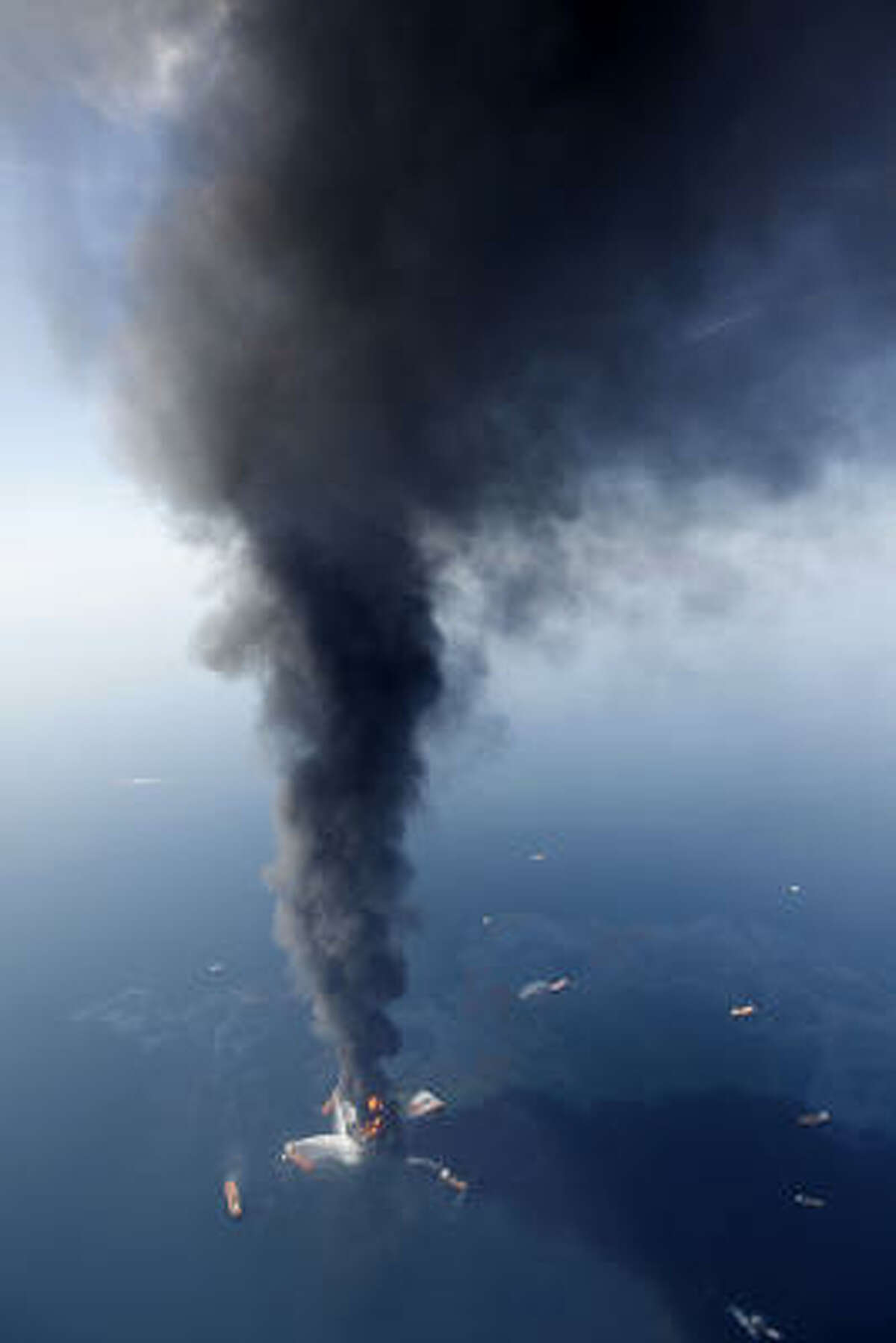 In this aerial photo taken in the Gulf of Mexico more than 50 miles southeast of Venice on Louisiana's tip, the Deepwater Horizon oil rig is seen burning Wednesday, April 21, 2010.