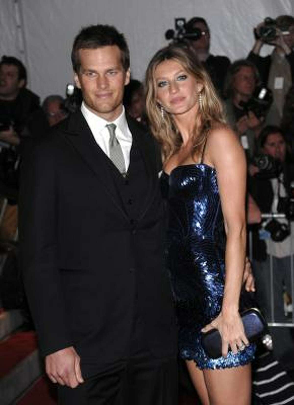 FILE - This is a May 4, 2009, file photo showing New England Patriots' Tom Brady and his wife, model Gisele Bundchen arriving at the Metropolitan Museum of Art's Costume Institute Gala in New York.