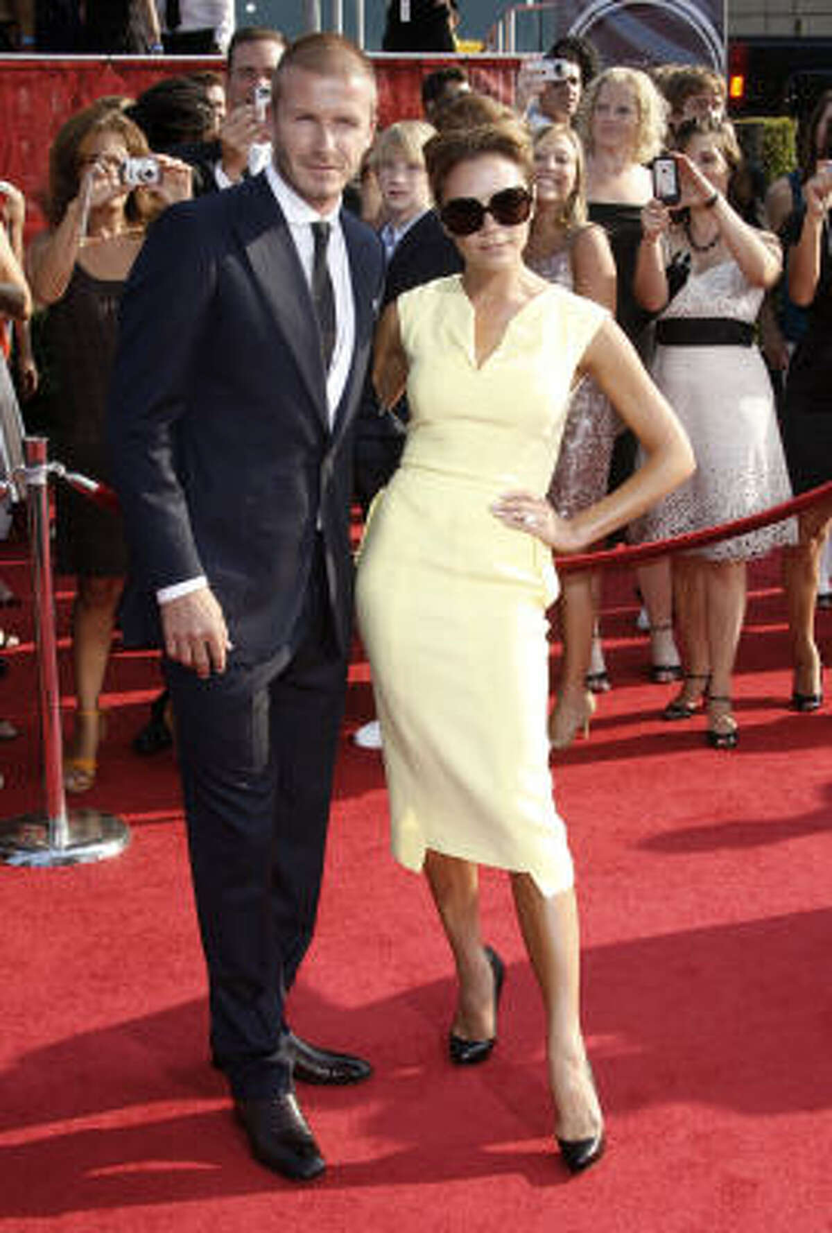 David Beckham and wife Victoria Beckham arrive at the ESPYs Awards on Wednesday July 16, 2008 in Los Angeles.