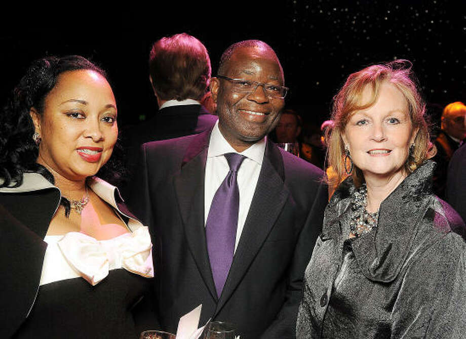 "From left: Anne and Sola Oyinlola with Aileen Reilly at the Theatre Under the Stars ""Night of a Thousand Stars"" gala at the Hobby Center for the Performing Arts. Photo: Dave Rossman, For The Chronicle"