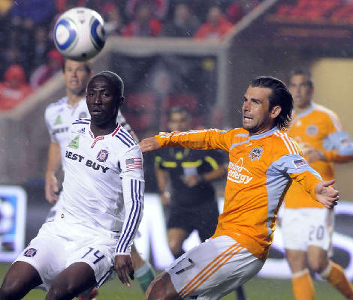 Chicago's Patrick Nyarko, left, and Dynamo defender Mike Chabala battle for a loose ball in Saturday's match. The Dynamo fell 2-0.