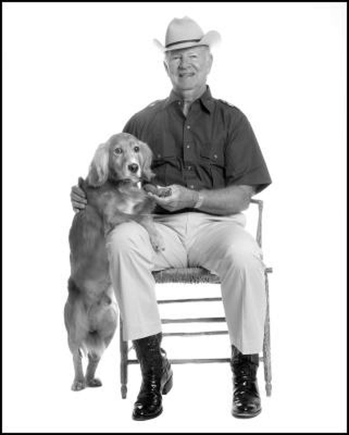 James Baker with his pet, from new photo book Top Dogs and Their Pets.