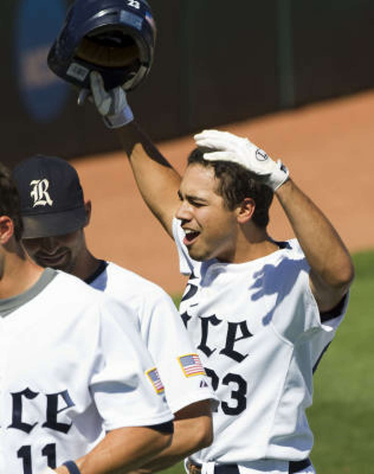 Rice third baseman Anthony Rendon (23) celebrates his three-run homer.