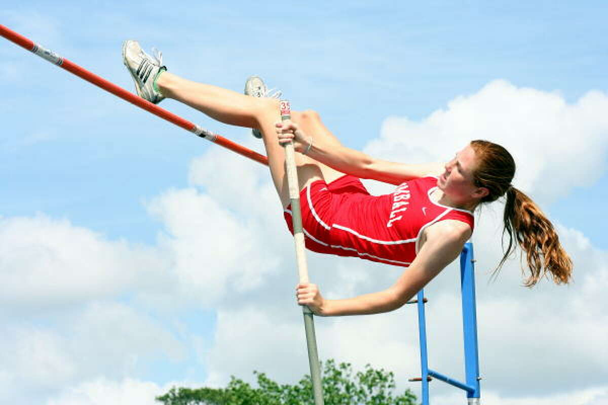 Tomball's Brittany Wooten clears the 12-foot high bar during the pole vault event.