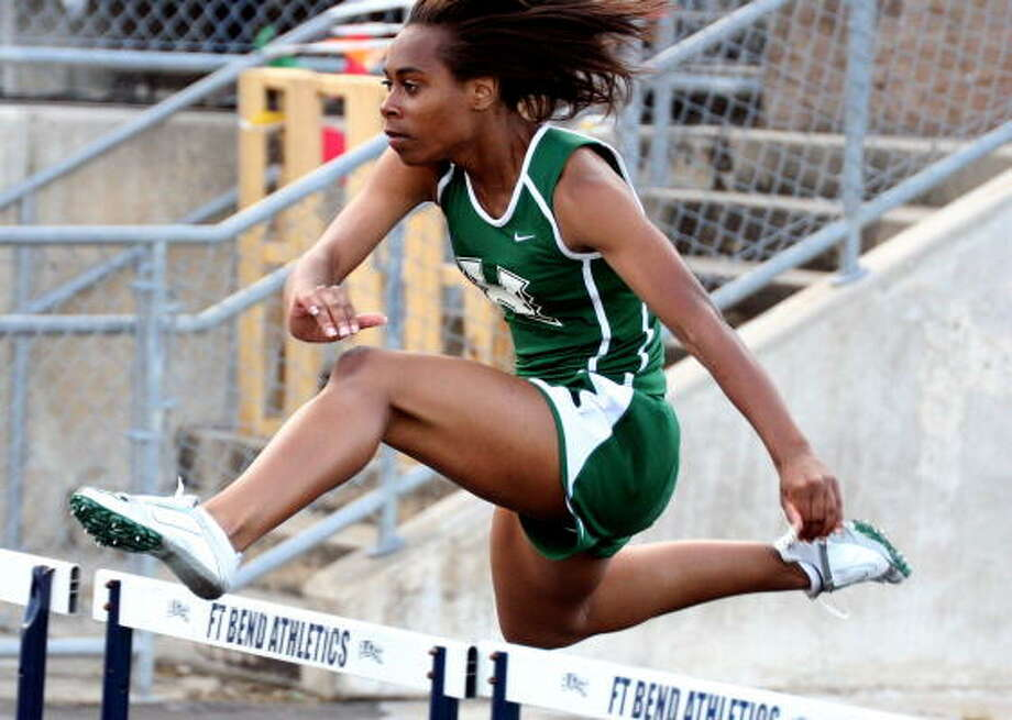 Hightowers' Chelsea Stephen ran away with the gold in the 100-meter hurdles. Photo: Gerald James, Chronicle