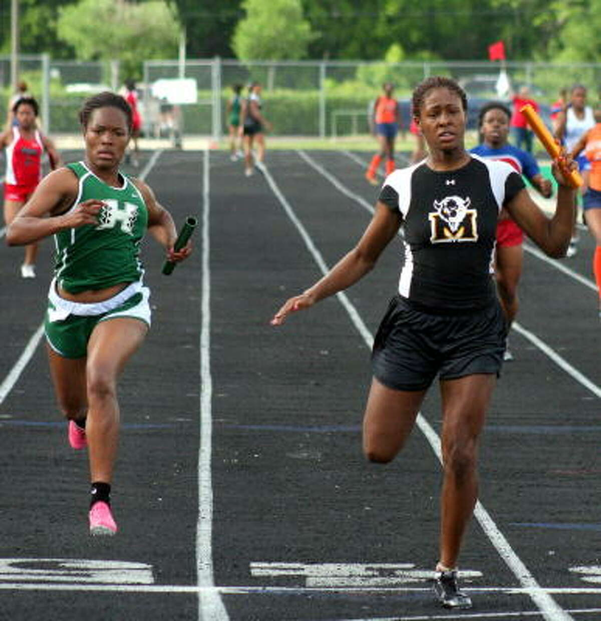 Marshall's Jhorden Hunter, right, edges Hightower's Franchelle Hill to help her team win gold in the 400-meter relay.