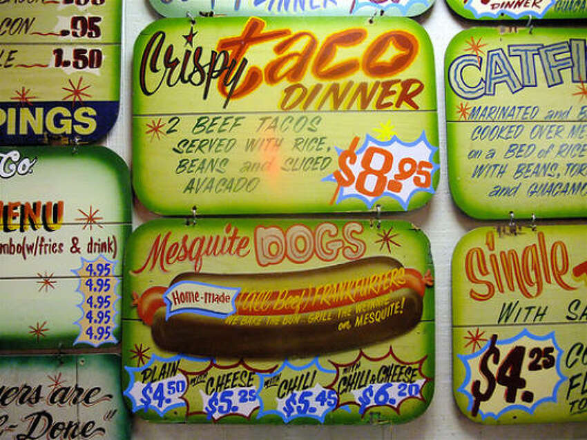 The prices have changed over the decades, but the handpainted signage at Goode Co. Taqueria remains the same.