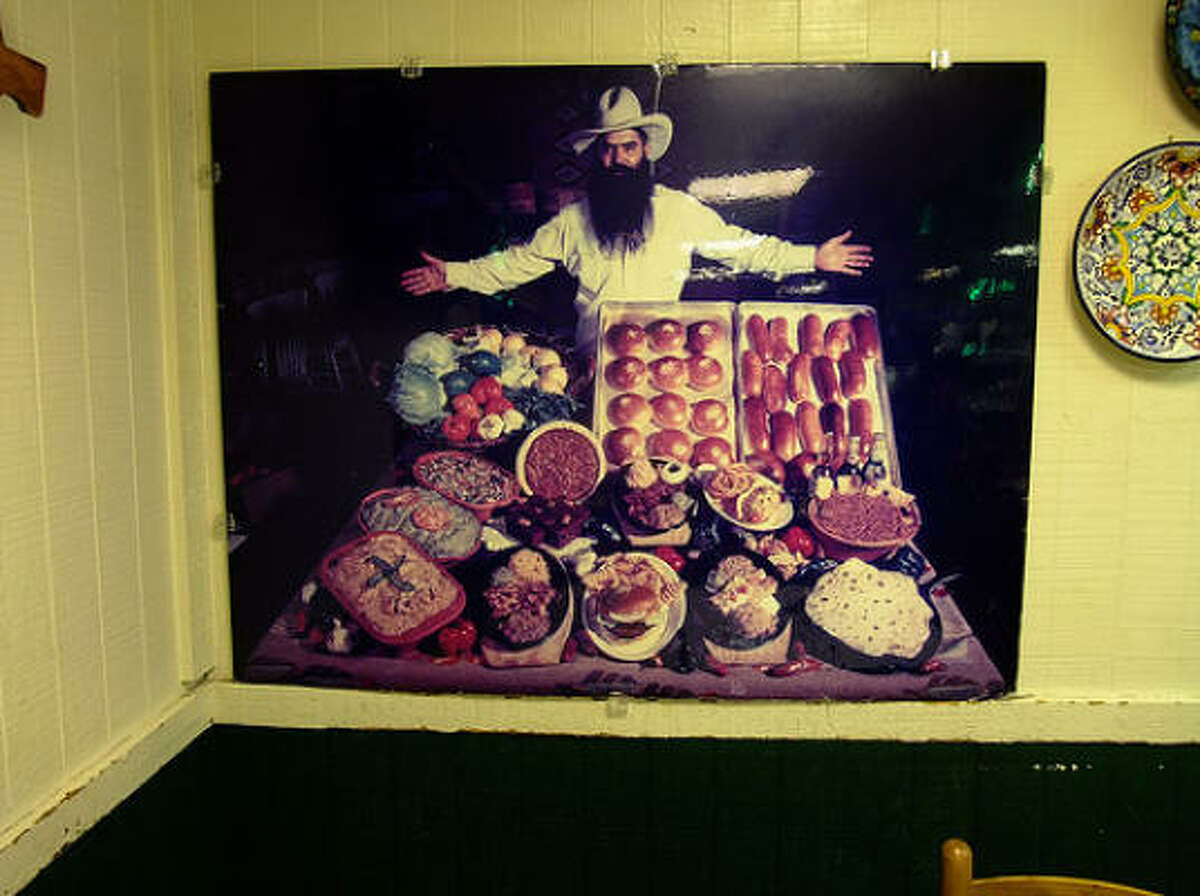 This photo portrait shows founder Jim Goode in the corner of the dining room at Goode Co. Taqueria.