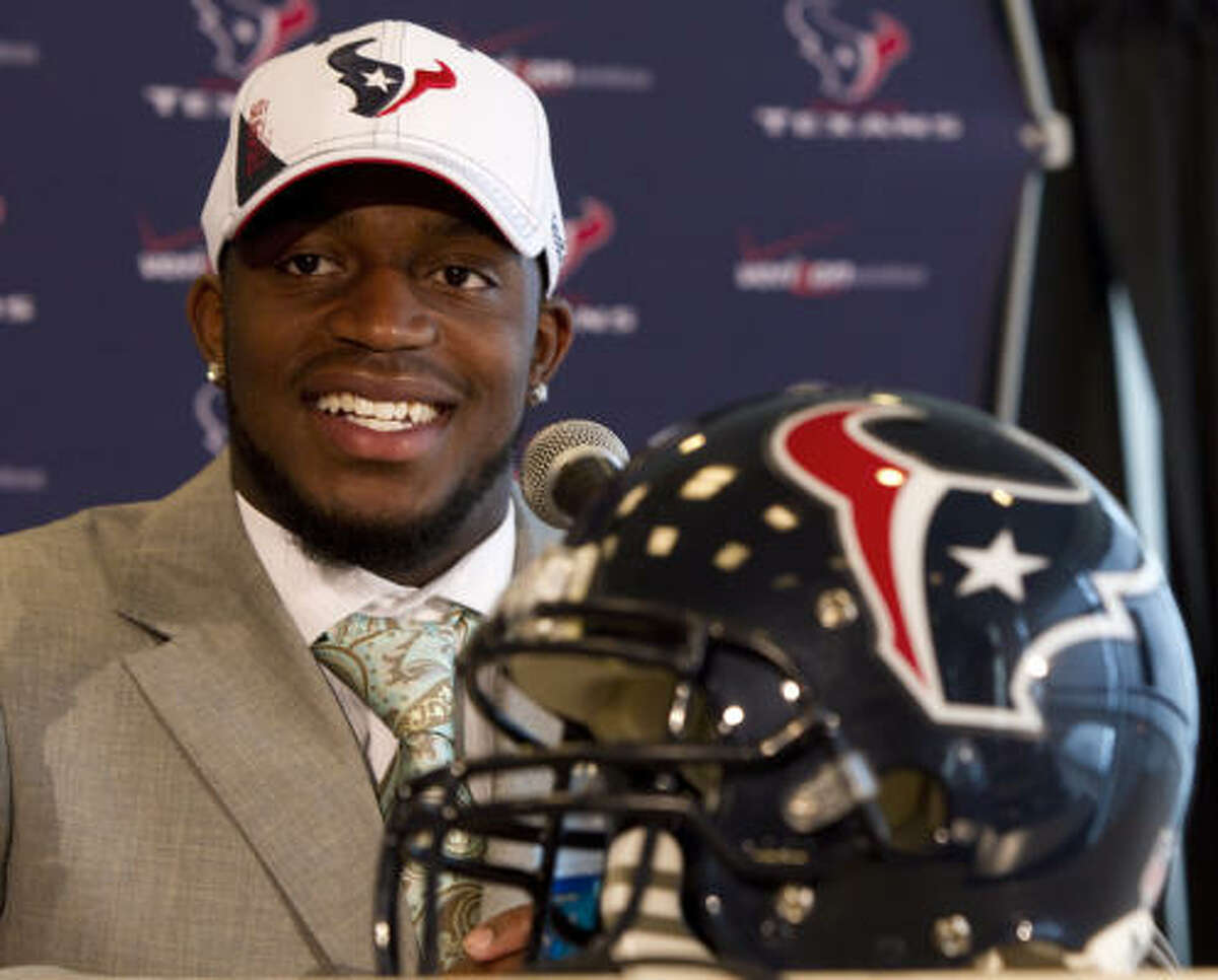 Texans first-round draft pick Kareem Jackson smiles during his first news conference Friday at Reliant Stadium. The Texans took the cornerback from Alabama with the 20th pick.