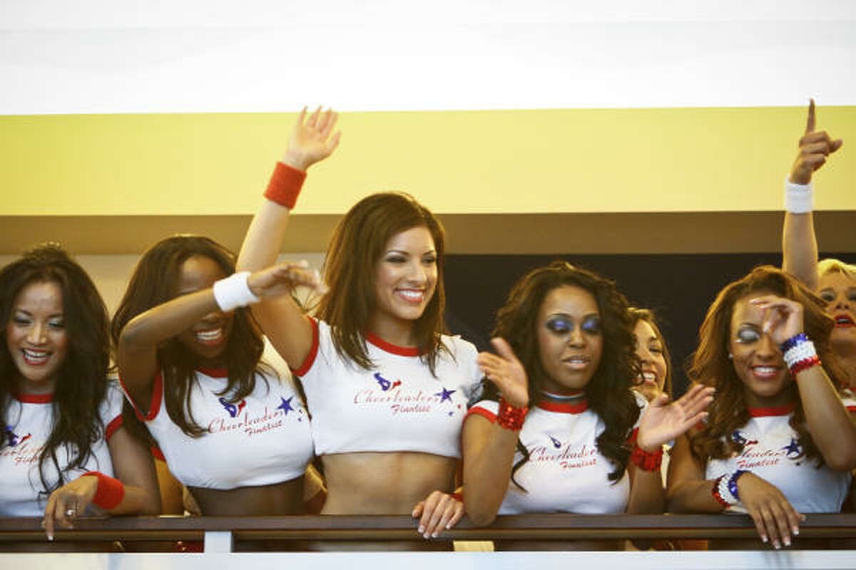 Texans cheerleaders wave to fans during the NFL draft party at Reliant Stadium.