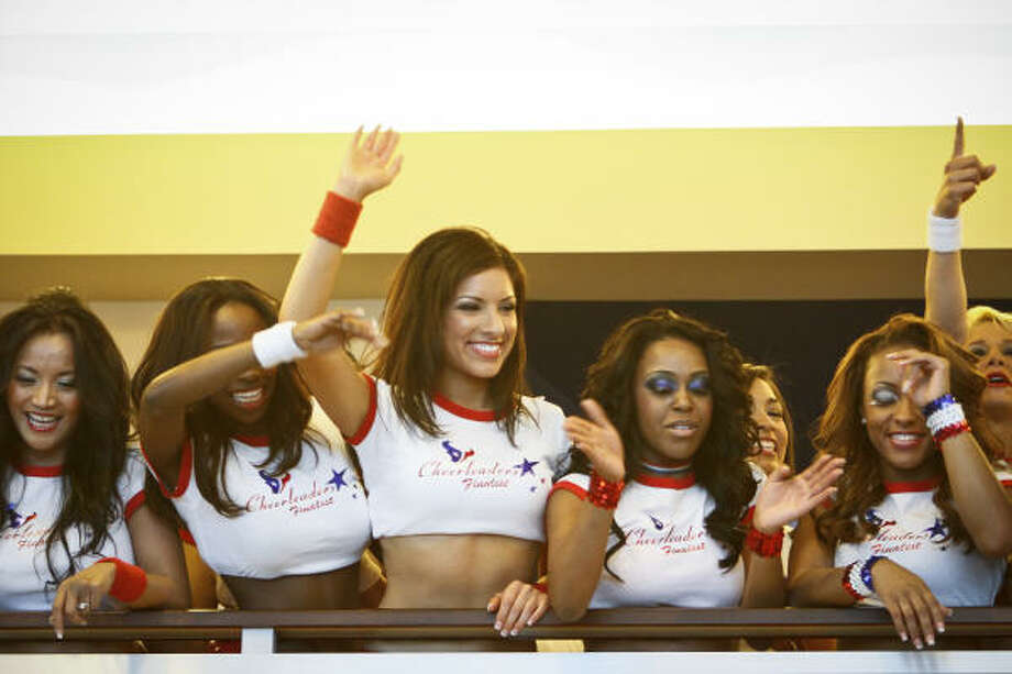 Texans cheerleaders wave to fans during the NFL draft party at Reliant Stadium. Photo: Michael Paulsen, Chronicle
